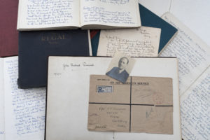 A collection of paper objects and diaries written by Dick Perceval