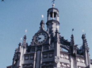 A colour image of the clock face and top of the Chichester Cross, West Street Chichester