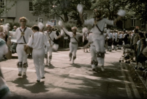 A colour image of a group of Morris Men performing in Horsham town centre