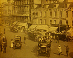 A still from Magical Margate (1925) showing charabancs on a Margate street