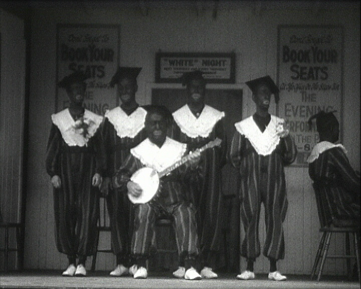 A still of 'Uncle Mack�s Minstrels' (1930-1931) showing the Minstrels on stage
