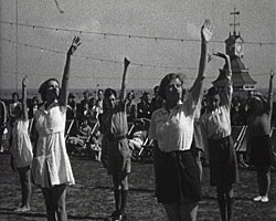 A still from [Town and Family Scenes at Broadstairs] (1929-1938) showing Keep-fit class participants