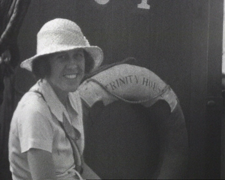 A still from [Broadstairs Items] (1927-1935) showing a woman with a life ring