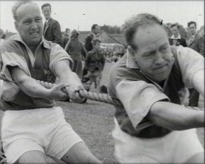 A Still from 'Westerham Gala Day' (1959) showing a tug of war match