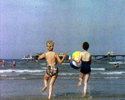 A still from 'A Date with the Sun' (1965) showing women on the beach