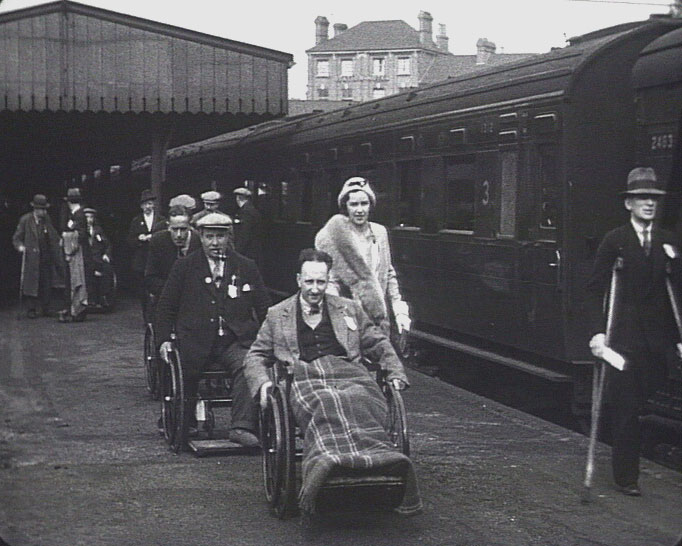 A still from 'Lest we forget' (1934) showing disabled ex-servicemen at a railway station
