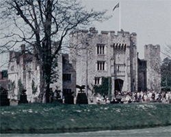 A colour still image taken from TID 10689, showing a wide exterior view of the front of Hever Castle, from across the gardens.