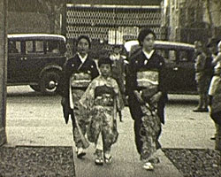A still from [Parades, In Japan] (1937?) showing women in traditional Japanese dress