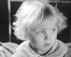 A still from 'St Bartholomew's Hospital' (ca. 1930) showing a girl on the children's ward