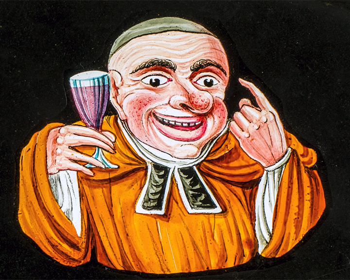 A still image taken from TID 14018, showing a double slipping magic lantern slide in a woodern mount, displaying a colour painted figure of an overweight monk with a drinkers nose enjoying a glass of wine, beckoning us with his finger.