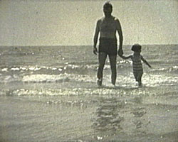 A Still from [At the Seaside] (ca.1935) - Joseph and Jocelyn Emberton (father and daughter) on the beach