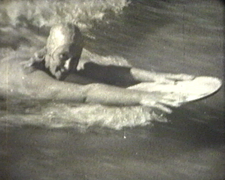 A Still from [At the Seaside] (ca.1935) - Kathleen Emberton, surfing