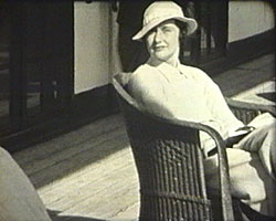A Still from [Christmas Cruise - Trip to Africa] (ca.1935) showing Kathleen Emberton on the ship's deck