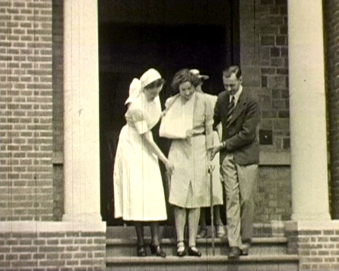A still from [The Royal Surrey County Hospital Fundraising Films] (ca.1936) showing a patient leaving the hospital