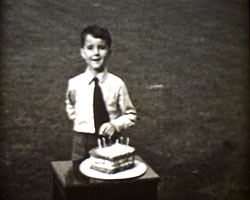 A still from [Horse show; Holiday at Eastbourne] (1946) - John Gowlland aged 7 with birthday cake