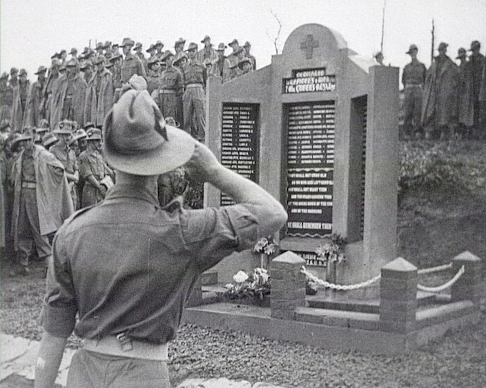 A still from 'Memorial in Burma' (ca.1945) showing a soldier saluting
