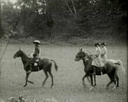 A still from [Local Scenes and Family Pictures] (1927-1929) - Horse riders in a pageant