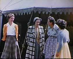 A still from Horley Coronation Fete (1953) - women at the fete