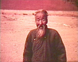 A still from [Visit to China and Korea] (1938?) showing a Chinese man