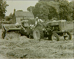 A still from 'Haytime' (1949?) - harvesting with a tractor