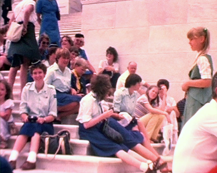 A still from 'Regnum District Girl Guides - USA Visit 1982' showing a group of Girl Guides in Washington