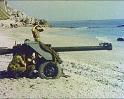 A still from [Recruiting for the Royal Sussex Regiment] (ca.1961) - artillery on a beach