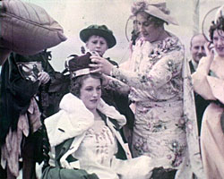 A still from Regis Review (1930s) showing the carnival queen being crowned
