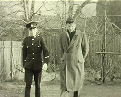 A still image taken from TID 320, showing Alva Lauste with his brother in law, who is dressed in a military uniform. The men are walking around the garden at the Lauste's West Wickham home.