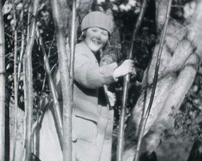 A still from 'Staley Family Domestic' (1930-1931) showing Pam Staley climbing a tree