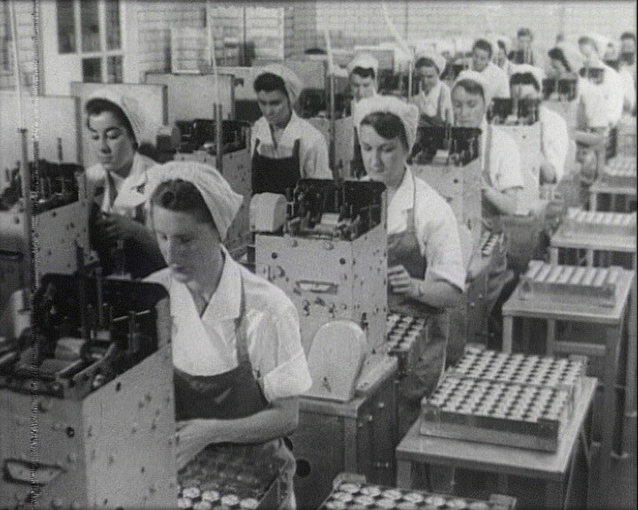 A still from 'A Family Tradition' (1954) showing workers in Shippam's meat factory