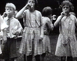 A still from [Miscellaneous Family Pictures] (1930-1937) - girls blowing bubbles