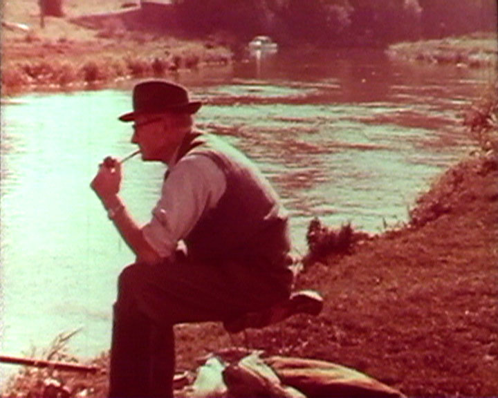 A still from Down to Sussex (1964) - a man fishing