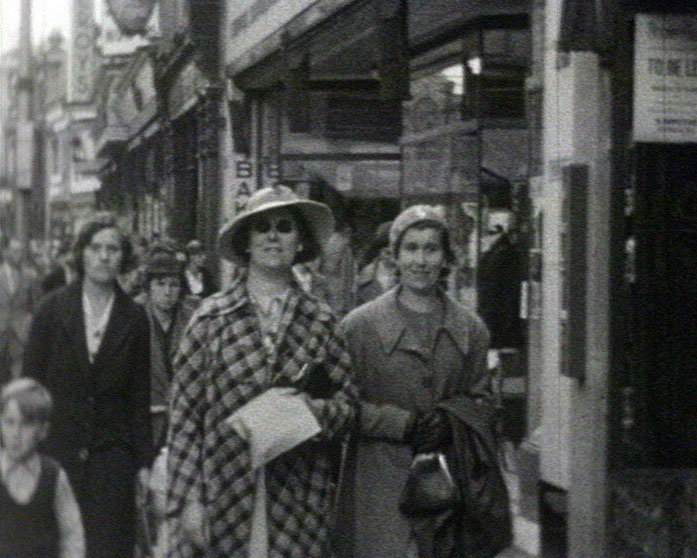 A still from [Sussex and Hampshire Scenes] (1930s) showing women shopping