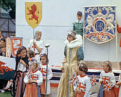 A still from 'Royal Celebration Coronation Lindfield' (1953) showing children performing a royalty-themed pageant