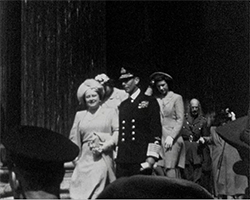 A black and white still image taken from TID 3419, showing HM The King, George VI accompanied by his wife Elizabeth, Queen Consort and their two daughters HRH Princess Elizabeth and HRH Princess Margaret leaving St Paul's Cathedral, making their way down the steps following the Thanksgiving service.