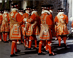 A colour still image taken from TID 3419, showing a group of Yeoman Warders from the Tower of London dressed in red and gold ceremonial dress uniforms gathered on The Mall ahead of the Royal Silver Wedding celebrations.