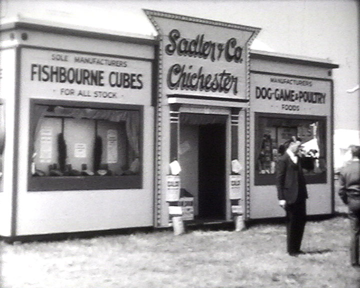 A still from [Jack Martin Pilot] (1937-1945?) showing the Sadler & Co. shopfront