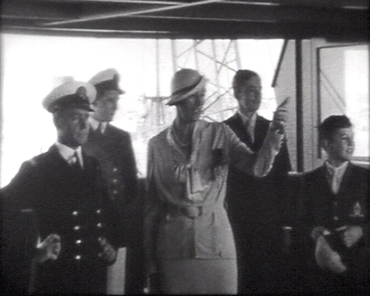 A still from [Australia visit and West Sussex] (1930-1935?) showing a woman with the ship's crew