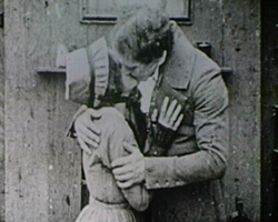 A still from 'Little Dorrit' (1920) - Little Dorrit and Arthur Clennam kiss