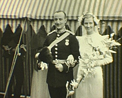 A Still from [Cochrane Wedding] (1937) - The bride and groom