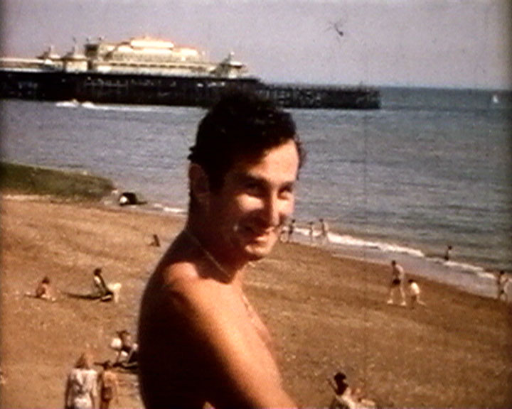 A still from 'Brighton Re-visited' (1969) - man on the beach