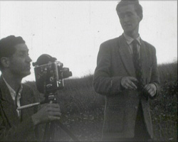 A still from Local News (1951) - two men with a cine camera