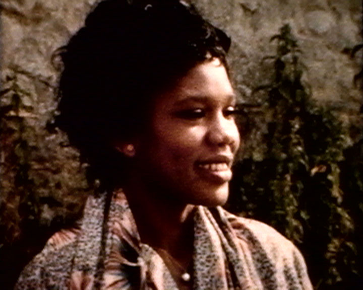 A still from 'Looking at Sussex' (1960-1962) - a young black woman