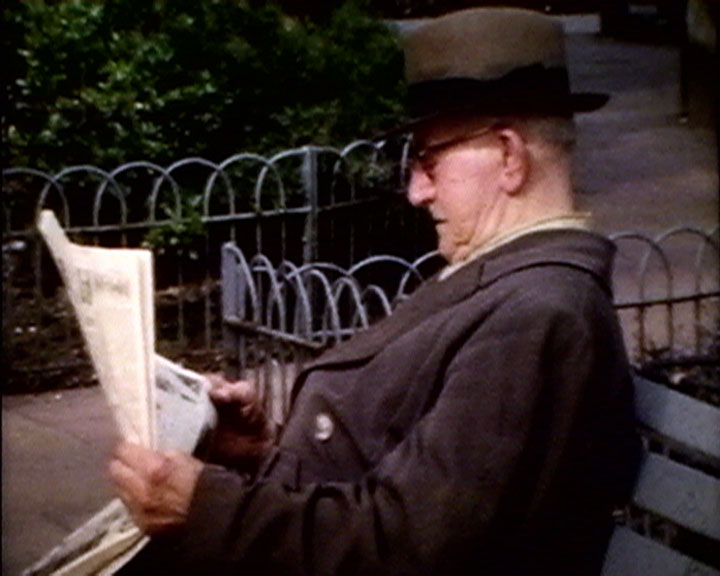 A still from 'Looking at Sussex' (1960-1962) - man reading a newspaper