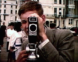 A still from 'Looking at Sussex' (1960-1962) - young man with a cine camera