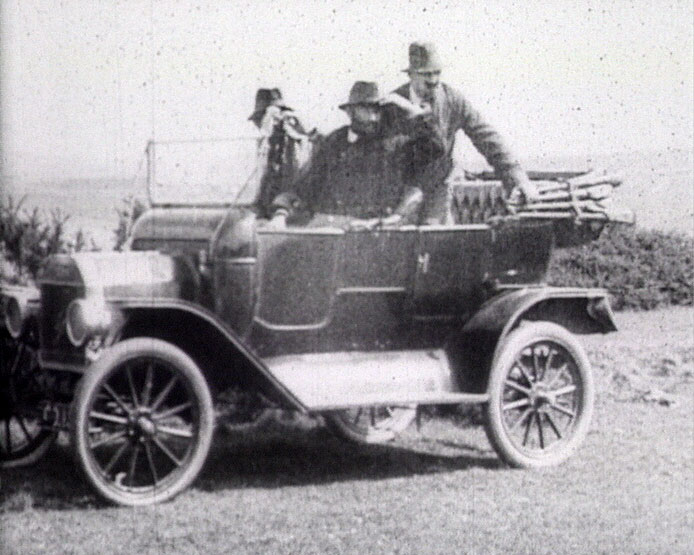 A still from 'The Motor Bandits' (1912) showing people in a car
