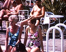 A still from [Holiday in Spain] (1968?) showing people sitting by a pool