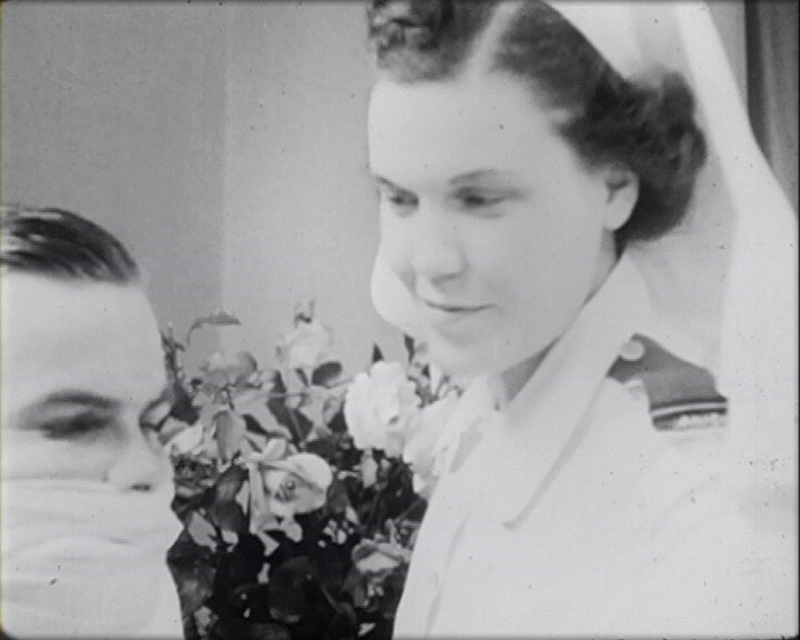 A still from 'New Faces Come Back' (1946) - a nurse and patient