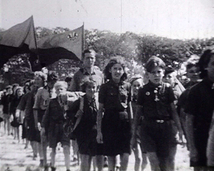 A still from Brighton International Children's Camp (1946) showing children marching at the camp