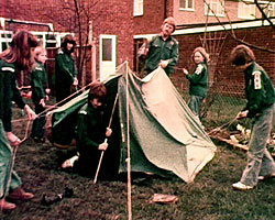 A still from 'Woodcraft Folk' (1975) showing people putting up a tent